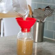 pouring broth in jar